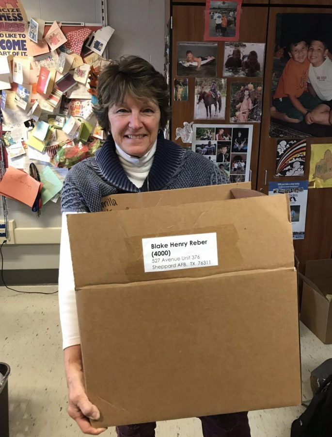 Mrs. McKinney revisits Dallastown after her retirement to help the current volunteer club package the boxes