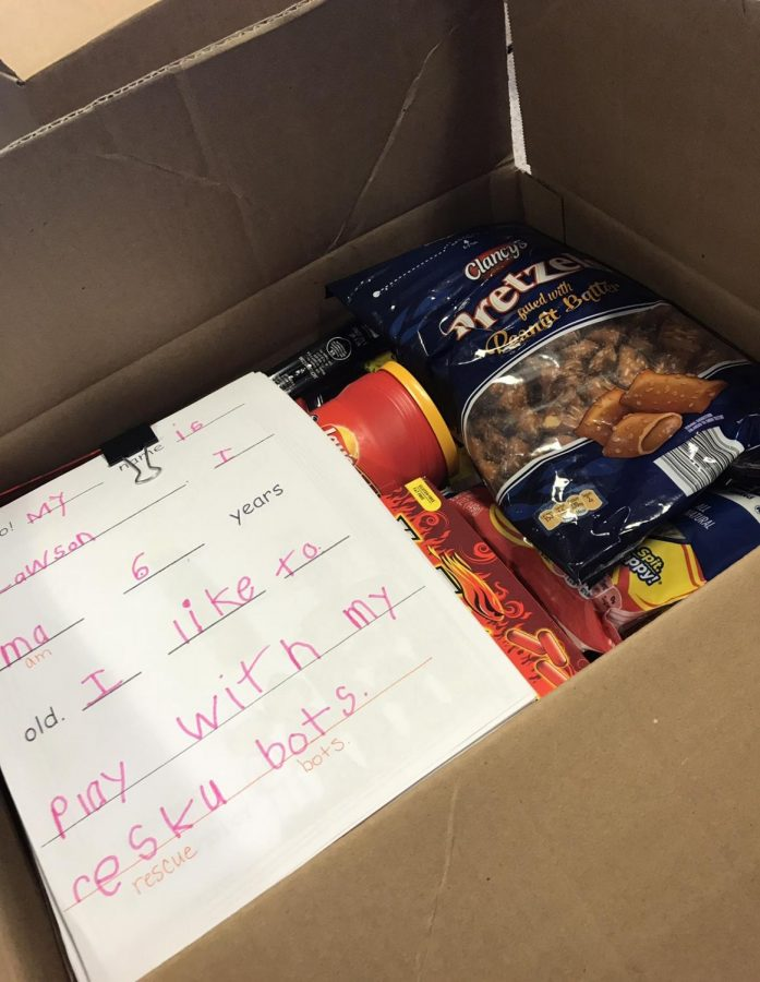 A look inside what goes into the packages. Here is a letter from an elementary student along with other snacks.