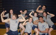 In this photo, circa 2015, students show their enthusiasm for gym class and show off the standard gym uniform of the pre-trimester era.