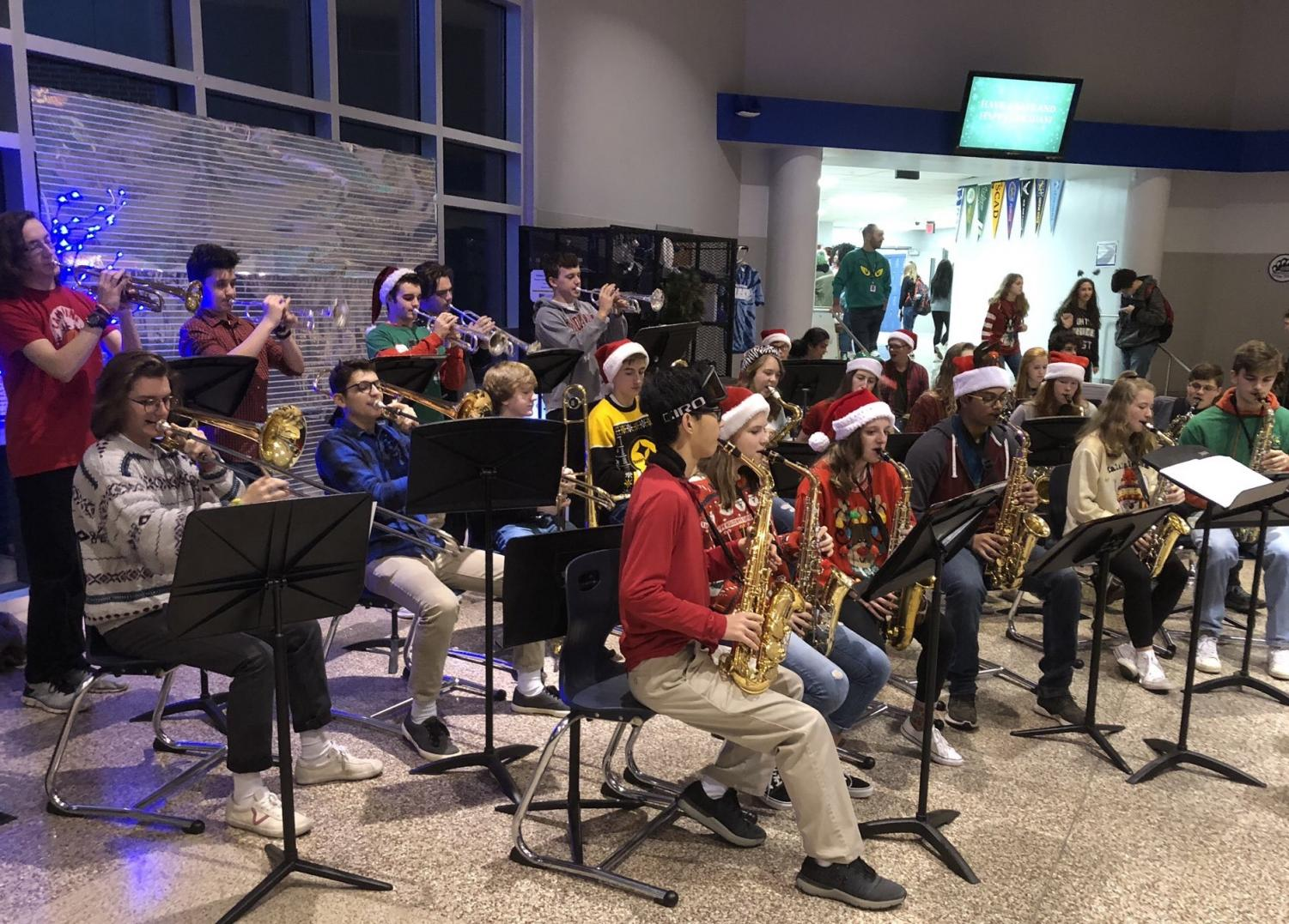 Members of the Jazz Band perform Friday morning in the front lobby to kick of Welcome to Winter Day. The last day before break was filled with food, music, assemblies, and ugly sweaters.
