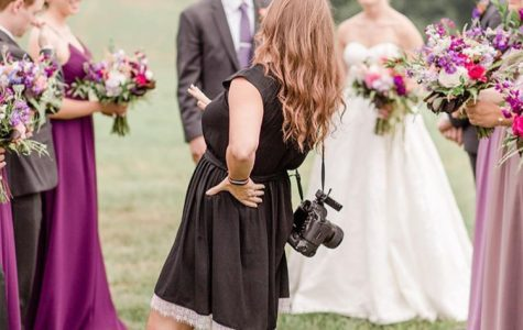 "Amanda Naylor in action during a wedding photo shot, this past summer. This summer Naylor hit her ""100 weddings"" marks, since she officially started and registered her business."