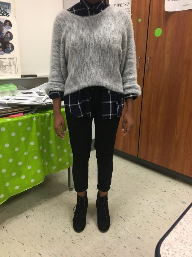 One simple way to pair navy and black is to wear black jeans with a navy shirt under a grey sweater like this Dallastown senior.