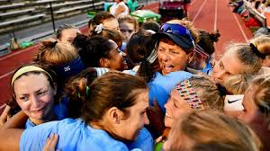 The Field Hockey team celebrating after head coach Jeri Myers 500 win this season.