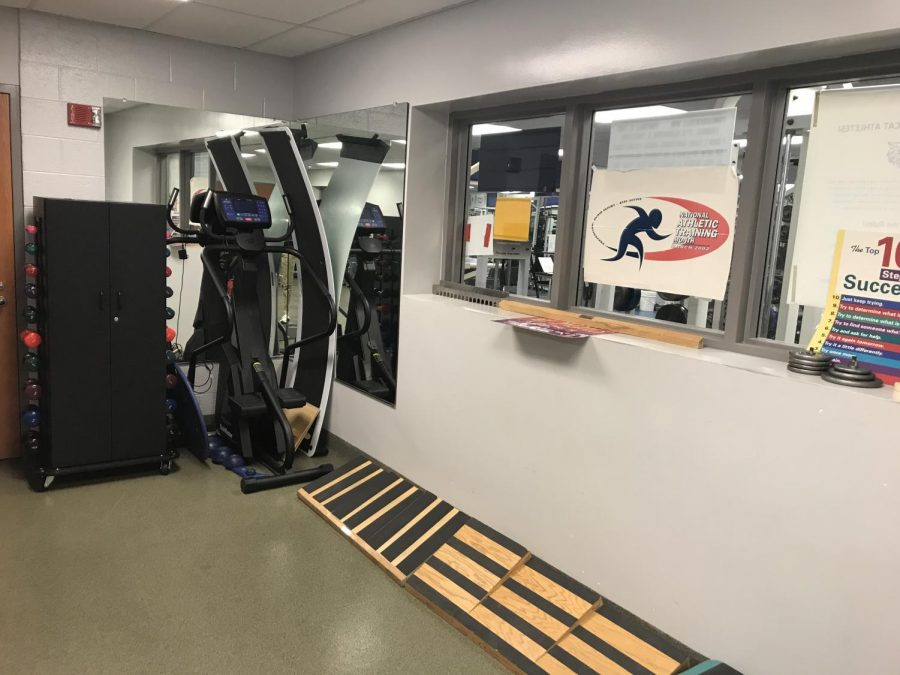 This machine and boards are used along with the weights for rehabilitation on lower body muscles and bones. The poster is also from the National Athletic Training Month which says