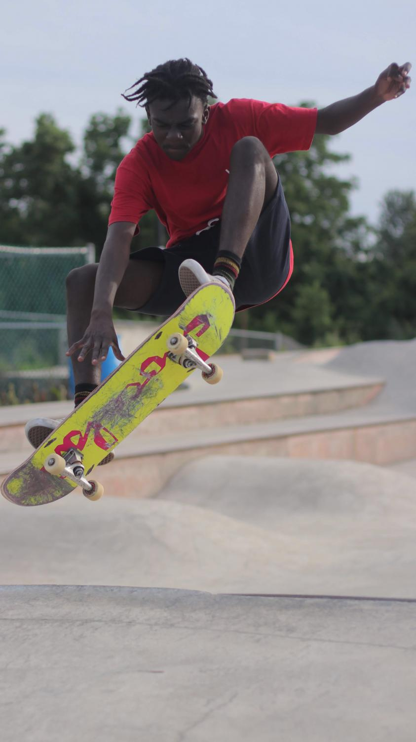 Dallastown senior Charles Asah, does an Indie grab off of a ramp at Reid Menzer. Asah is not letting recent violence keep him from skating at the park.