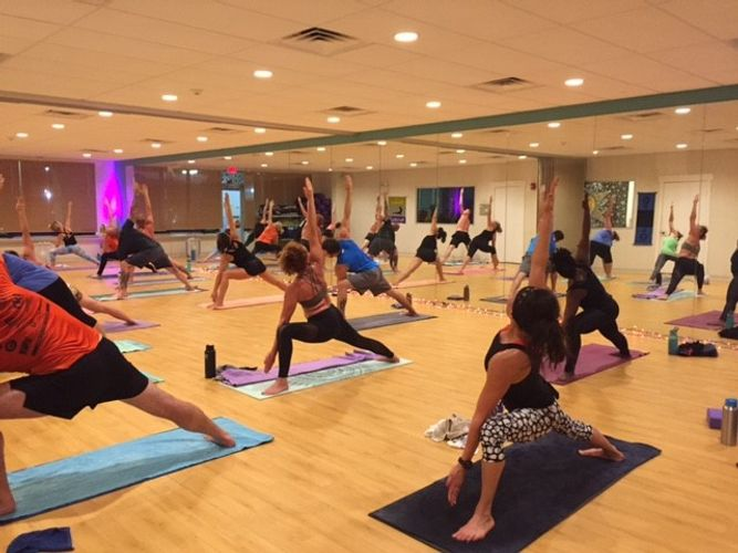 Participants+are+engaging+in+one+of+the+many+styles+of+yoga++offered+at+Twisted+Roots.