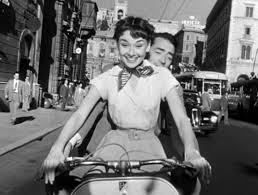 Princess Ann (Audrey Hepburn) enjoying her day away from her famous life with Joe Bradley (Gregory Peck)