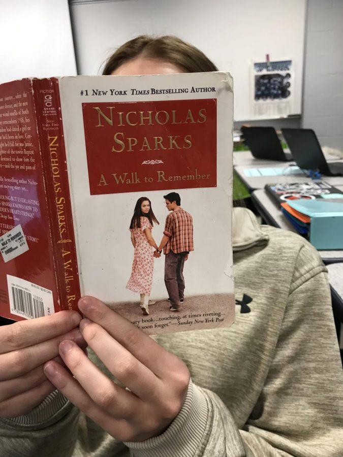 Senior, Brielle Berry, enjoying this romance novel.