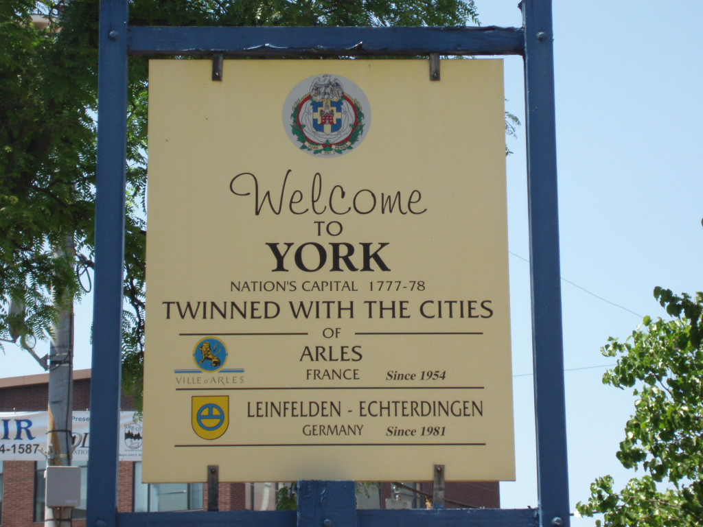 The York Twinning Association is twinned with the cities of Arles, France, since 1954, and Leinfelden-Echterdingen, Germany, since 1981. The sign is currently located near the NW corner of the intersection of N. Pershing Avenue and E. Market Streets.