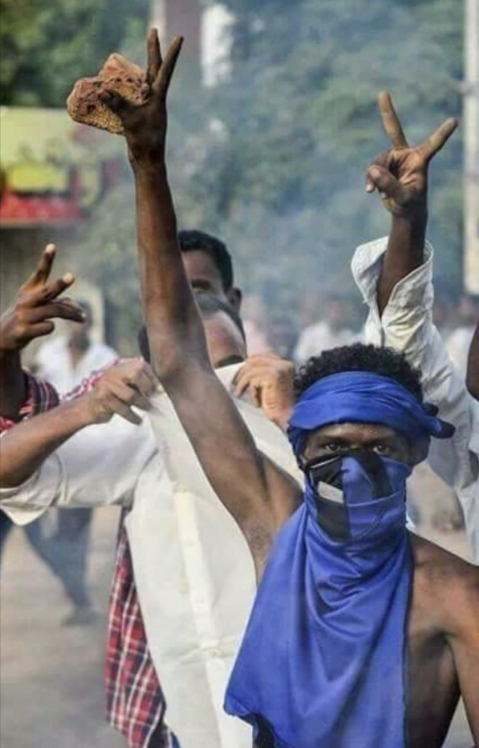 This iconic photo from an early uprising in Sudan shows citizens being tear gassed at a protest. The man depicted has become a symbol for the Sudanese people, some even dressing like him for current protests.