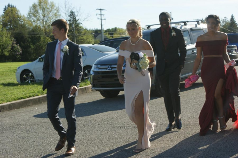 Students and their guests make their way into Wisehaven Event Center for Dallastown Prom on Saturday, April 27, 2019.