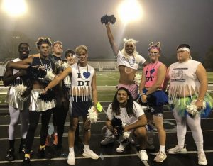 One of the favorite attractions of the annual Powder Puff game is on the sidelines. Senior football players dressed up as cheerleaders to support the players and to entertain the crowd.