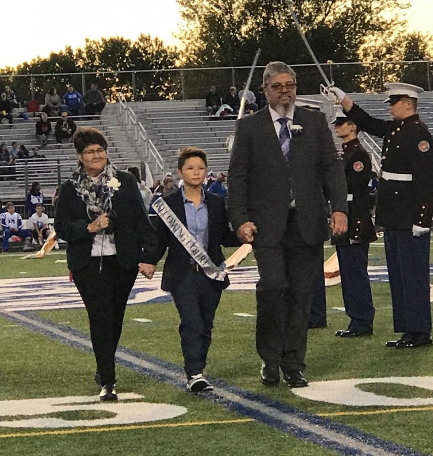 Senior members of the 2019 Homecoming Court were recognized before the game with their parents.