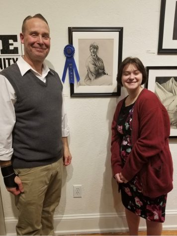 "Sophomore Libby Fullam and Dallastown art teacher Mr. Myers beside winning pencil sketch ""Untitled."""