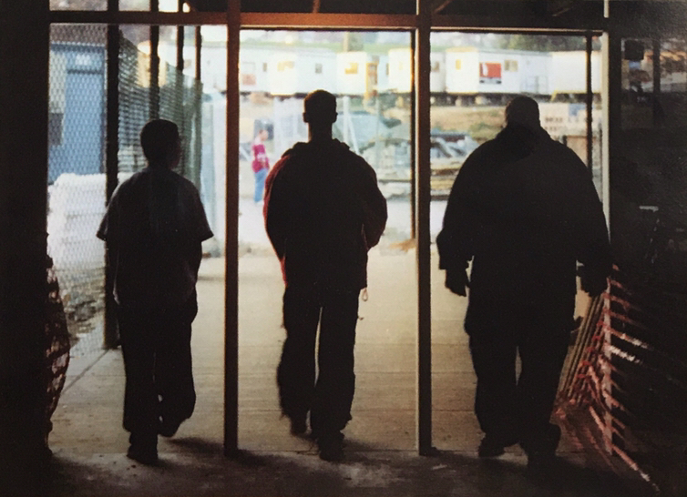 Wooden door frames mark exits to the temporary pods outside, located in the main driveways of both the middle and high schools. Many students had at least one class in a pod per day.