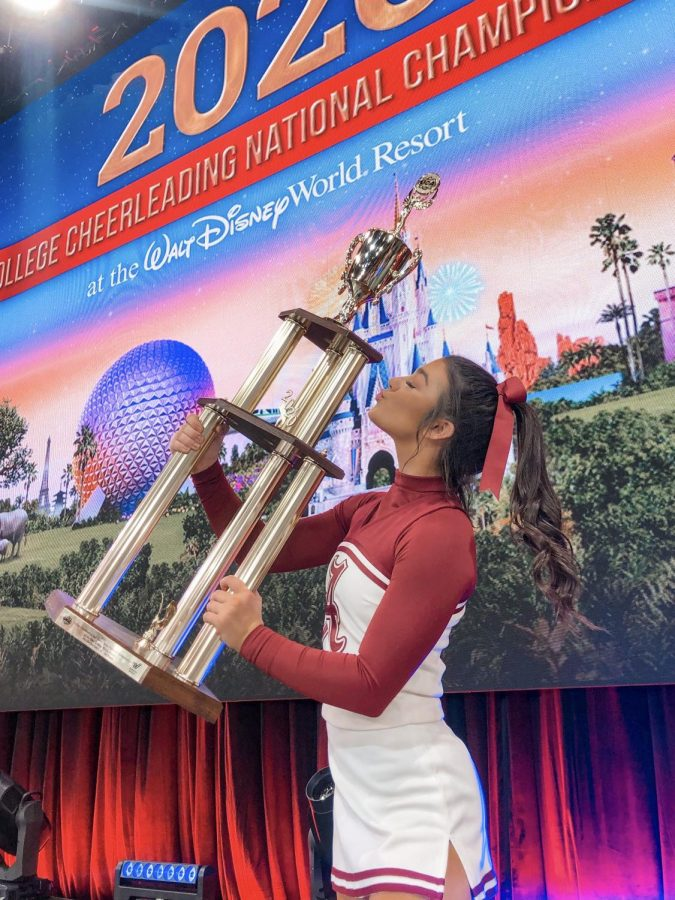 Helmer holds the first place trophy after Alabama's all-girl cheer team won the Division 1A National Champion title. The All-Girl cheer team is coached by Brandon Prince and Jennifer Thrasher, director of spirit programs at University of Alabama.