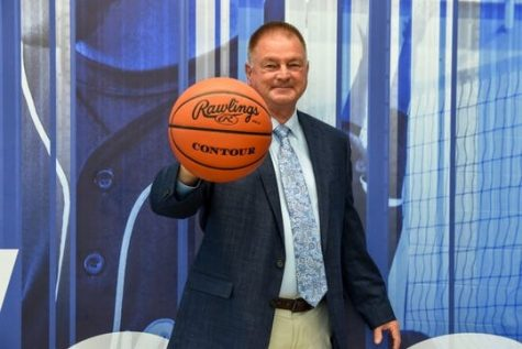 Mr. Harvey, ex-Dallastown Athletic Director, poses for a picture before his first game as head coach for the women