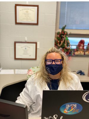 Dallastown High School Nurse Whitney Sams spends much of her day this year at her desk monitoring students and symptoms of COVID-19.