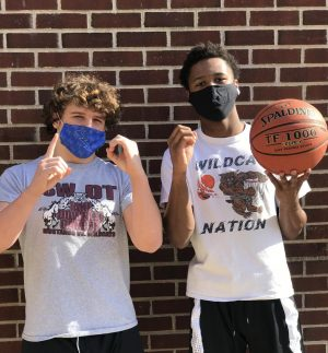 Dallastown seniors Brooks Gable (left) and Michael Dickson (right) were worried they might not even have their respective winter sports seasons this year. Not only were they able to compete, but they both joined the record books with Gable's 100th career victory in wrestling and Dickson's 1000th point scored in basketball.
