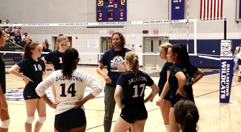 Dallastown girls Varsity Coach, Shannon Werner talks to her players. While in a huddle, in between sets.