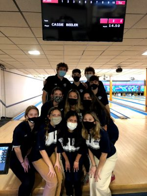 Some of the bowling club members posing for a picture during one of their 2020-2021 season matches. The bowling club has become a popular way to socialize and make new friends.
