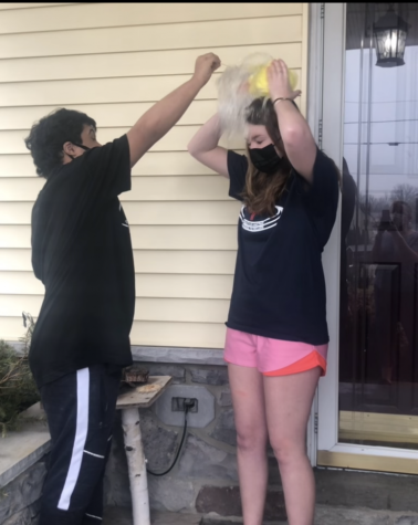 Dallastown senior Katie Queenan (right) lets her friend Michael (left) pop the ice-cold water balloon number two over her head on February 28. Queenan has been involved in Special Olympics and unified sports since her freshman year of high school.