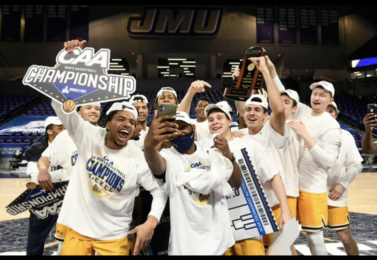 Former Dallastown graduate, Julian Adams (front left), celebrates with the Drexel men's basketball team with their win in the CAA conference championship game. Winning the CAA championship helped Drexel into the NCAA Basketball Tournament.