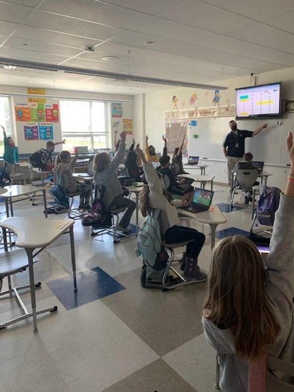 Mr. Koons, a 4th grade teacher at DAIS, interacts with his class while during in person learning. Even through masks, the Intermediate School is still an enjoyable environment for all people in the building, or through a Zoom meeting!