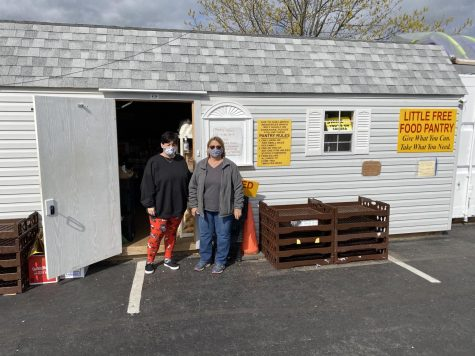 Driving into the back parking lot of Living Word Church you will find a little building filled with compassion and food and showing that is the two volunteers in this photo.