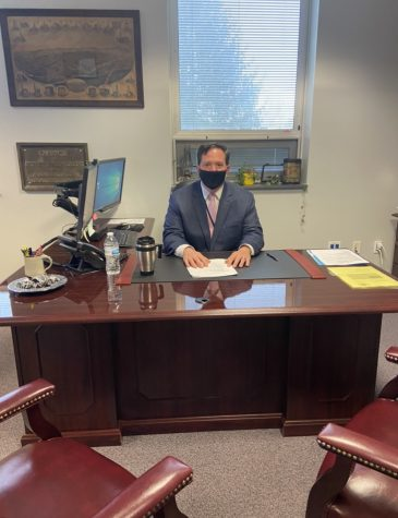 Dallastown super intendent, Dr.Doll, sitting at his desk. He believes in balance and that there is benefits to having both virtual snow days and traditional snow days.