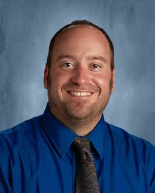 Although Business teacher  Mr. Robinson has only been at DHS for three years, he became a Wildcat after teaching 11 years at Spring Grove.