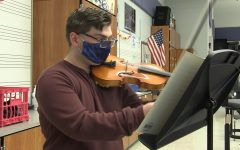Senior Collin Snyder is a triple threat in the music department as a member of the band, orchestra, and chorus.